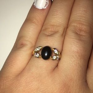 18k gold, black and diamond size 7 ring!